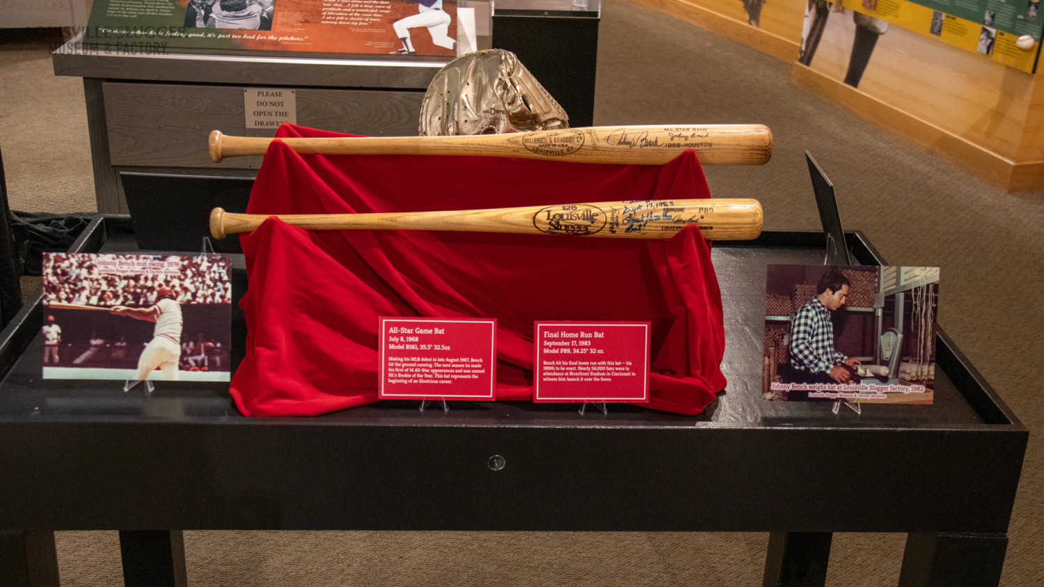 A straight on view of two bats from Johnny Bench's personal collection on display at Louisville Slugger Museum & Factory.