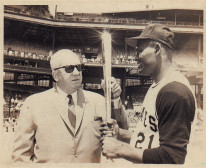 Clemente poses with National League president Warren Giles and his newly awarded Silver Bat Award for the 1964 NL Batting Championship, 1965